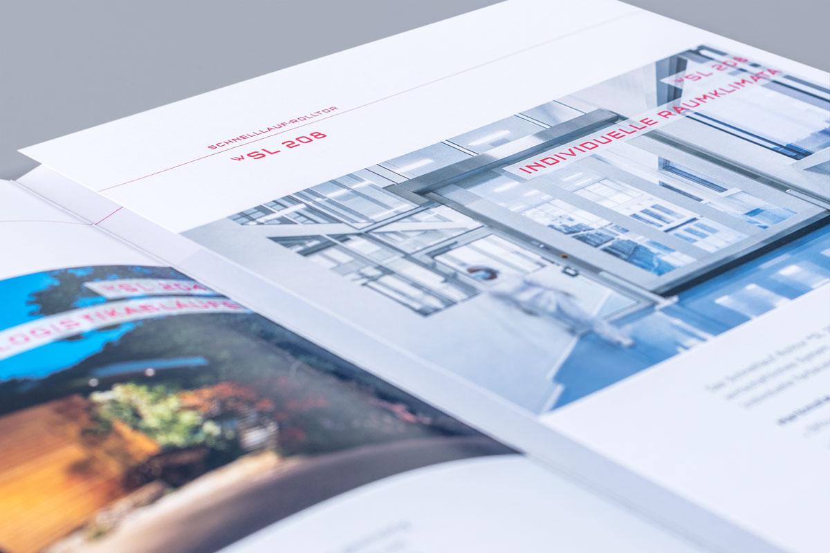 Geöffnete Wolfisberg Broschüre im neuen Corporate Design