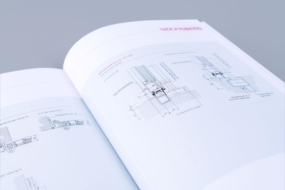 Zeichnung in einer geöffneten Wolfisberg Broschüre im neuen Corporate Design